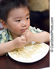 eating baby to grab pasta