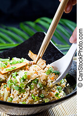 eating chinese fry rice - a person eating chinese fried rice...