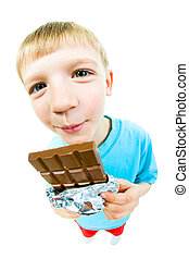 Eating chocolate - Portrait of happy boy with bar of...