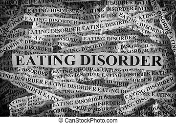 Torn pieces of paper with the words Eating Disorder