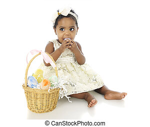 Eating Easter Eggs - An adorable baby girl all dressed up...