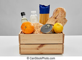 food in wooden box on table