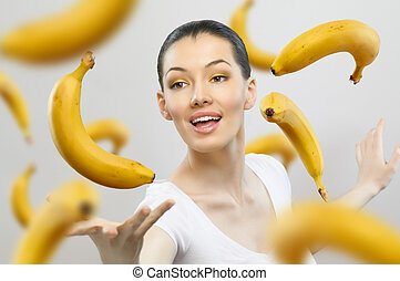 eating healthy food - a girl with a ripe yellow banana
