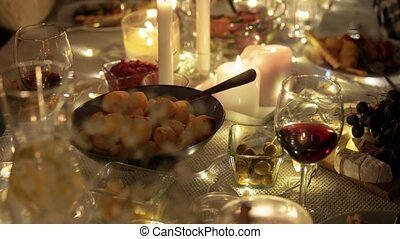 food and drinks on table at home dinner party - eating, ...