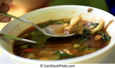 Eating hot and sour soup with shrimp and spicy. Thai style -...