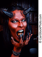 eating insects - Horned Devil with insects in the mouth. ...