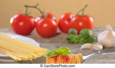 eating italian spaghetti with tomat