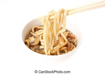 Eating Japanese udon noodles with chopsticks.