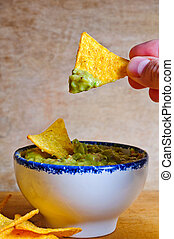 Eating nachos with dip - Eating nachos with avocado ...