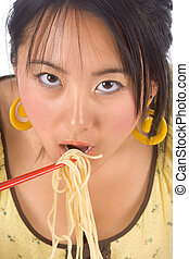 Eating noodles with chopsticks