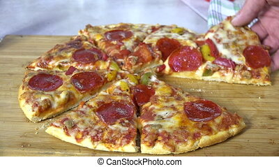 Eating pepperoni pizza - Taking a slice of pepperoni pizza...
