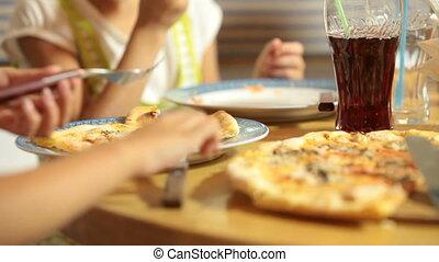 Eating Pizza in Restaurant