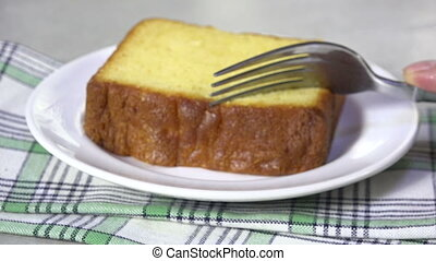 Eating pound cake - Taking a bit of a slice of pound cake