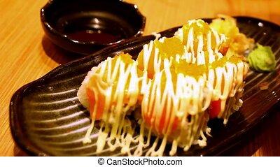 Eating rolls with salmon Philadelphia Maki Sushi. Macro fast speed motion