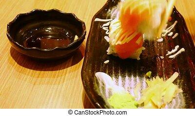 Eating rolls with salmon Philadelphia Maki Sushi. Macro video