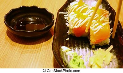 Eating rolls with salmon Philadelphia Maki Sushi.