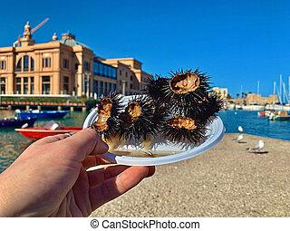 Eating sea urchins caviar in Bari, Italy.