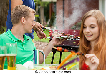 Eating snacks on a barbecue