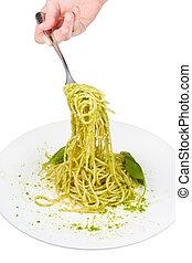 eating spaghetti isolated on white background