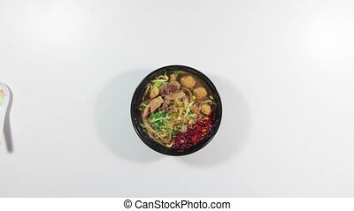 eating spicy asian pork soup with noodle timelapse