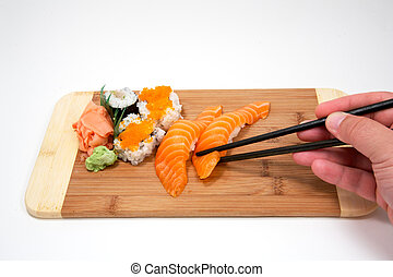 eating sushi with bamboo sticks flatlay closeup of woman. Black Bedroom Furniture Sets. Home Design Ideas
