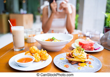 eating variety food for breakfast in morning