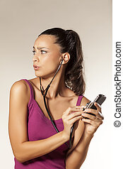 eavesdrop - young pretty startled girl uses a stethoscope to...