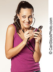 eavesdrop - young beautiful smiling girl uses a stethoscope...