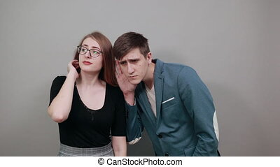 Eavesdropping, espionage, gossip, holding hand near head and...