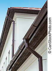 Eavestrough with downspout - Roof detail - modern gutter and...