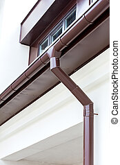 Eavestrough with downspout - Drainpipe on the roof of a...