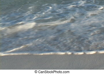 Ebb Tide - Close-up of waves slowly retreating from shore.