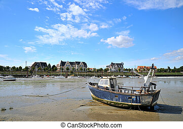 Ebb tide in the little harbor in Normandy