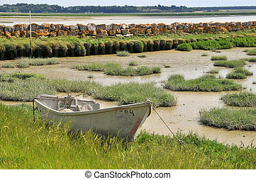 Ebb tide - Little boat with ebb tide at the Normandy coast