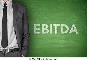 EBITDA on blackboard - Business acronym EBITDA Earnings...