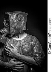 Ebola infection concept, man with red gas mask