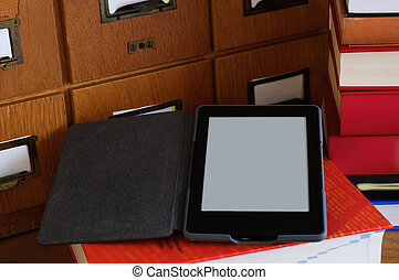 Ebook Reader in a Library  - New Technology Concept