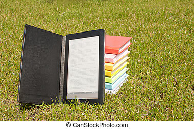 Ebook reader with a stack of books