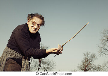 Dowsing rod  Dowsing wirh dividing rod to locate ground