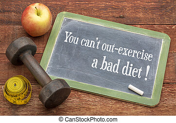 You cannot out-exercise a bad diet - slate blackboard sign against weathered red painted barn wood with a dumbbell, apple and tape measure