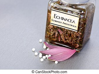 Echinacea Officinalis plant extract in glass bottle, homeopathic pills in front