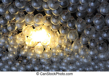 Eco energy saving light bulb , one glowing compact...