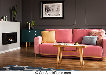 Eco fireplace in real photo of dark living room interior...