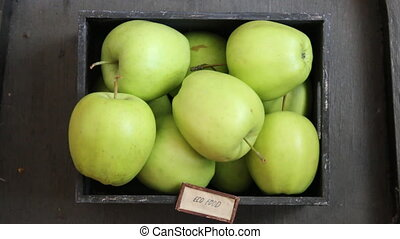 Eco food idea, green apples on a black table and text