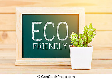 Eco friendly sign message on green chalkboard.