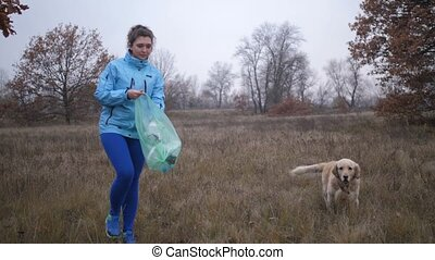 Eco friendly woman picking up litter outdoors - Eco friendly...