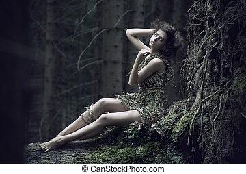 Eco girl lying on the trunk