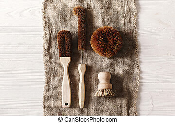 eco natural coconut brushes  flat lay on rustic background. sustainable lifestyle concept. zero waste. plastic free items. stop plastic pollution. reuse, reduce, recycle, refuse