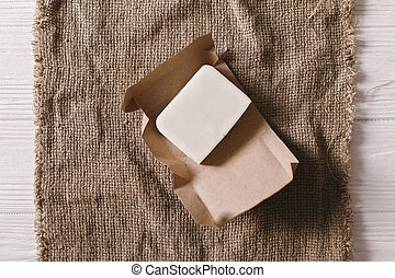eco natural coconut soap flat lay on rustic background. sustainable lifestyle concept. zero waste. plastic free items. stop plastic pollution. reuse, reduce, recycle, refuse