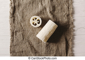 eco natural luffa brush  flat lay on rustic background.  sustainable lifestyle concept. zero waste. plastic free items. stop plastic pollution. reuse, reduce, recycle, refuse